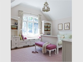 Young girl's bedroom with custom millwork and furniture, pink and patterned