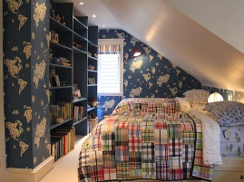 View of the length of the room with playful plaid quilts