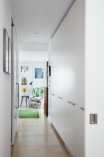Custom hall closets provide storage for the condo