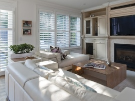 Family Room with leather sectional and custom acrylic table